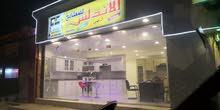 معرض مطابخ + معرض منجره في مكان واحد وشارع تجاري
