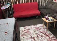كنبه متحركة تفرد علي شكل سرير كبير لون احمر