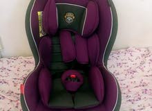 BABY CAR SEAT FOR 6 MONTHS TO 4 YEAR OLD BABIES- USED ONLY 2 WEEKS-180 AED