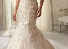 Angelina Faccenda فستان عرس ابيض ماركه