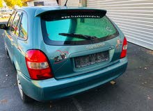 Turquoise Mazda 323 2001 for sale