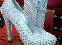 احذية والبسة