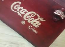 صندوق حديد ل تخزين وفتح الكوكاكولا