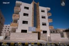 شقة طابق ثاني للبيع في ام نوارة بالقرب من حدائق الملكة رانيا بدفعة اولى والباقي اقساط