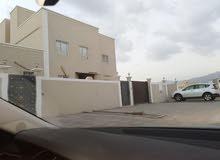 بنايه مع منزل للبيع في نزوى