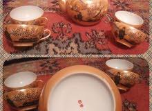 إبريق شاي و فناجين