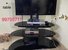 للبيع تلفزيون سوني مع الطاولةSony tv lcd 42