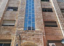 شقه 130 م بالقرب من مستشفى الامير حمزه ضاحية الاقصى