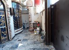 بيت لبيع مساحة 100 متر قرب جسر خالد  وعليه شارعين