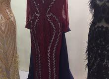 فستان لي بيع استعمل ساعه بس لون احمر عنبي مع ذليل