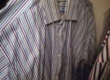 ملابس رجالي ماركات عالمية اصلية كبيرة قمصان xxx وبلاطين احجام كبيرة خصر54  قمصان