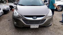 Hyundai Tuscani 2013 For sale - Brown color