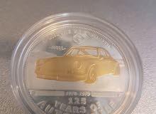 إصدار نادر على شكل عملة  لسيارة بورش ذهب وفضة