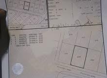 للبيع ارض سكني في الخوض 7 مستويه تماما