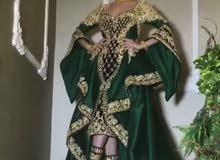 فستان سهرة  تفته ملون في قطيفه اسود  تطريز جلد مقطع في اليزر