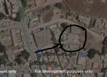 ارض مساحة 205 متر 15 واجهة و 14 عمق يعني 15×14