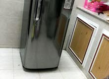 A double coat and abrand new fridge  s there to be sold