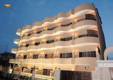 الله يبارك فندق جميل وضخم 7نجوم في طرابلس للبيع روعة في التصميم بسعر منافس