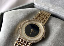 baume and mercier 18k and diamond watch