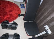 chair with dumbbells