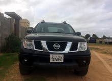 km mileage Nissan Frontier for sale