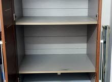 cupboard and single bed with matters in good condition