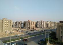شقة + رووف كامل للبيع بالشيخ زايد الحي الثامن على المحور الرئيسي