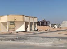 مبني محلات تجارية واستوديوهات قريب من شارع الشبخ محمد بن زايد 200 متر مربع