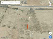 قطعة ارض سكنيه في منطقة 7 تطل على 3 شوارع