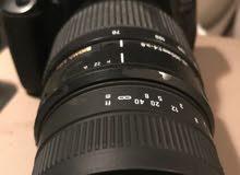 كاميرا كانون 600 مع عدسه سيقما 70-300 مانع اهتزاز