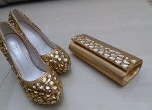حذاء وحقيبة
