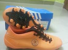 حذاء للملاعب العشبية