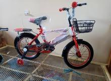 عجلات اطفال بخوذة