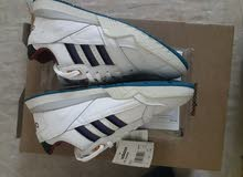 adididas white lined shoes