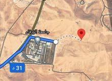 للبيع ارض 512 م خلف جامعه الزرقاء الغباوي