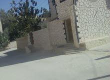 عمارة للبيع  في الزرقاء حي الزواهرة