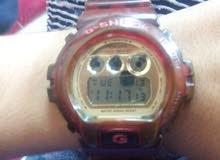 ساعة كاسيو جي شوك اصلي لون ذهبي داخلي وشفاف خارجي