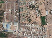 أرض في الكريمية خلف السوق المحروق 340م