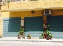 بيت قديم(مع امكانية الهدم والبناء) ومحلات تجارية للبيع جبل عمان شارع خرفان