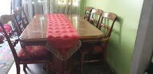 طاولة طعام قابلة للتمديد خشبي مع عدد 6 كراسي