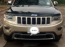 Gold Jeep Grand Cherokee 2014 for sale