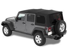 soft top jeep wrangler 4 doors