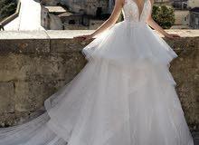 wedding dress Nicole Milano designer