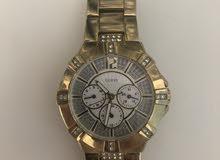 ساعة guess ذهبية للبيع