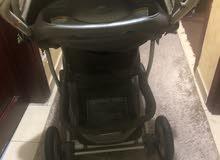 عربة اطفال مع مقعد