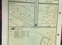 ارض للبيع مخطط الحومانية بجنب المنازل كورنر ومفتوحة من ثلاث جهات