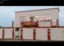 منزل للبيع في سيح الاحمر مربع 6 خلف محطة المها بالقرب من الخدمات