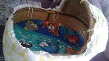 سريرين اطفال واحد قصيب والثاني كهربا بطاريات متحرك للبيع