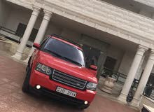 Automatic Red Land Rover 2012 for rent