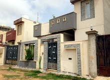 منزل في طريق المطار للبيع او استبدال بمنزل في تاجوراء